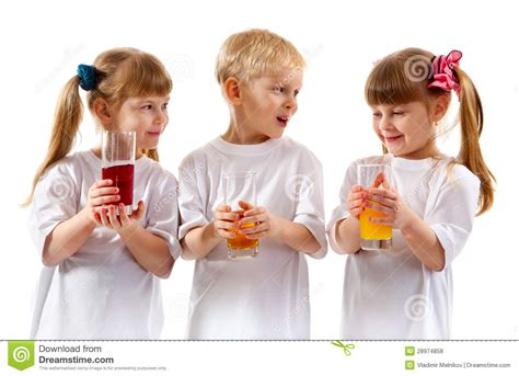 Smiling Children With A Glass Of Juice Stock Photo