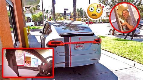 tesla jake paul inside self driving tesla in drive thru prank freakouts