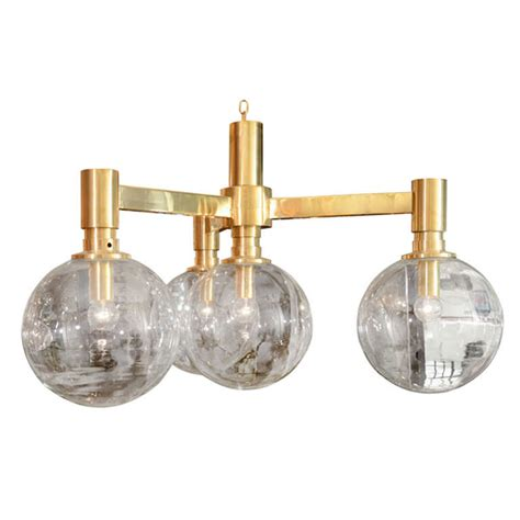 brass three arm chandelier with clear glass spherical