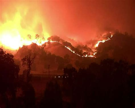 Flames from a backfire move away from a barn threatened by. California wildfires some of largest in state history