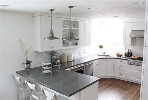 White With Gray Countertops. Shaker Cabinets. These Go To