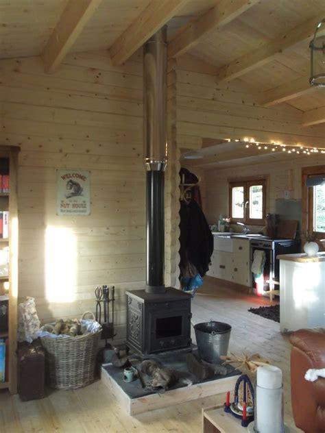 rezultat imagine pentru log cabin wood stoves log burner