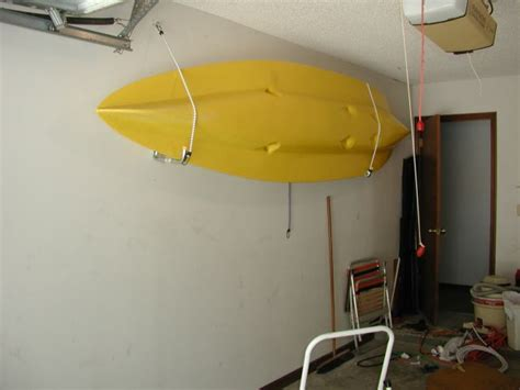 hang kayak in garage boy s and their toys