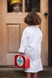 Girl playing doctor making house call - Stock Image F006 ...