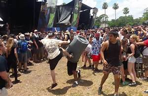 Watch this guy try (and fail) to mosh inside of a trash ...
