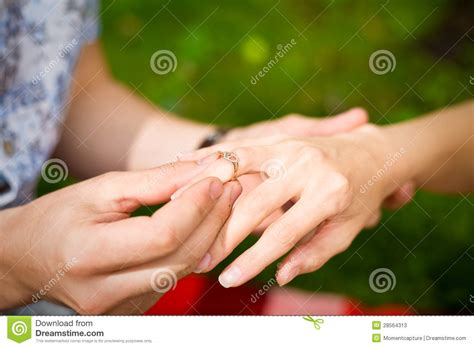 a of a man putting a ring a s finger stock photos image 28564313