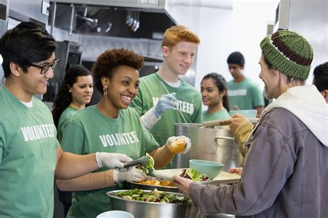soup kitchen in college students feed the hungry by rescuing food headed