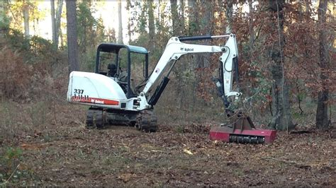 bobcat mini excavator  torrent mulcher clearing small