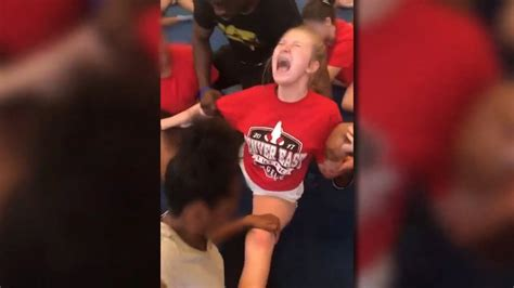 Videos Show Cheerleaders Repeatedly Forced Into Splits
