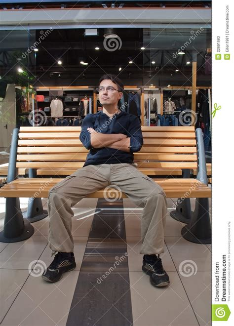 portrait  young man  bench  mall stock image image