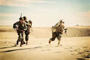 Wwii Medic And Soldiers Running For Cover From Enemy Fire ...