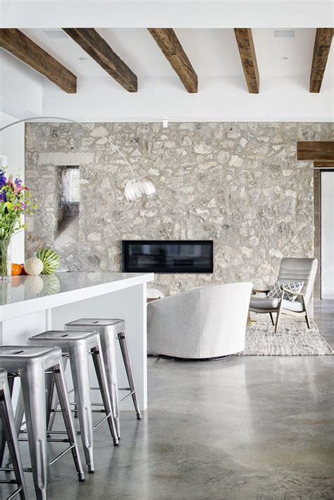 polished concrete floors  feature stone wall