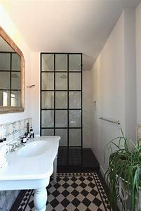 crittall style shower screen with a matte black frame made
