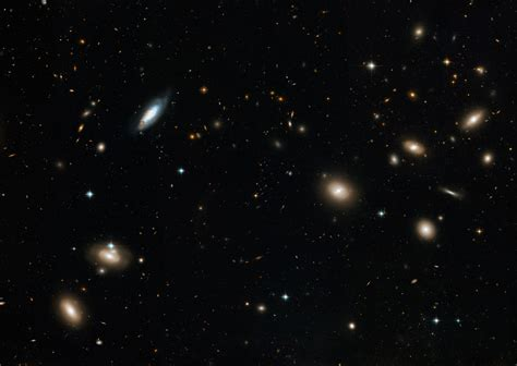 hubbles sweeping view   coma galaxy cluster esahubble
