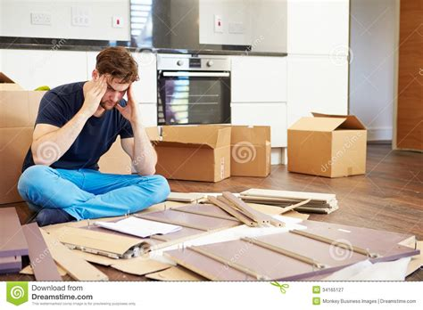frustrated putting together self assembly furniture