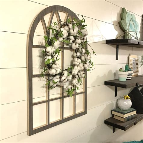 You can use acrylic glass paint to decorate the glass with vintage. arch window frame wall decor