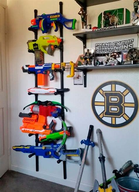 Wish i lived in an alternate universe where everything is forsooth, here are some more inspirations to get your creative foam dart ideas churning in your succulent brain space! Ready, aim, tidy! 8 ways to store Nerf guns | Mum's Grapevine