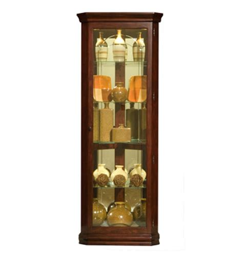 corner curio cabinet in victorian cherry by pulaski home