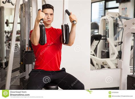 Pec Deck Machine Workout by Exercising His Chest Muscles Stock Photo Image