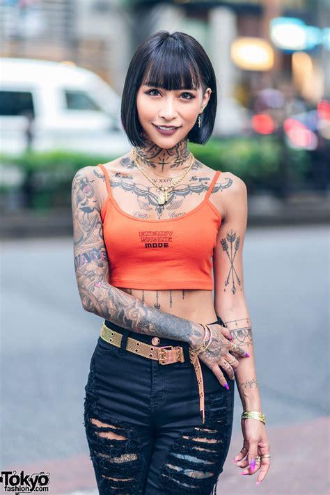 japanese hairmakeup artist model  harajuku  tattoos crop top top secret shorts yello