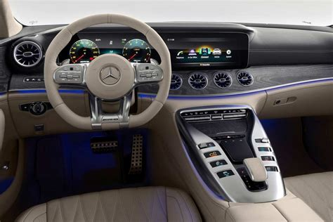The sculptural instrument panel forms an interesting contrast here to. Mercedes-AMG GT 4-Door Coupe; Performance Meets Practicality | AUTOBICS