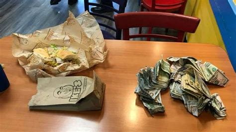 hungry cash waving bank robbery suspect arrested eating