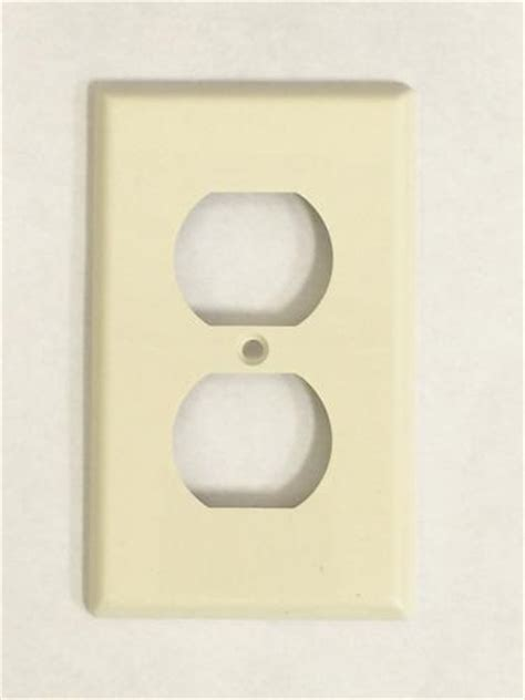light almond duplex wall plate at menards 174