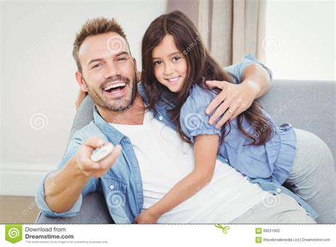 Smiling Family Hugging Sitting On Sofa Royalty-free Stock