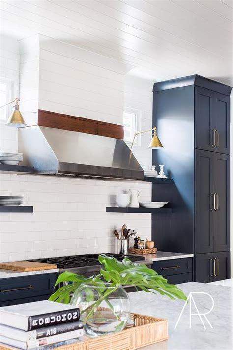 white kitchen cabinets  aged brass hardware