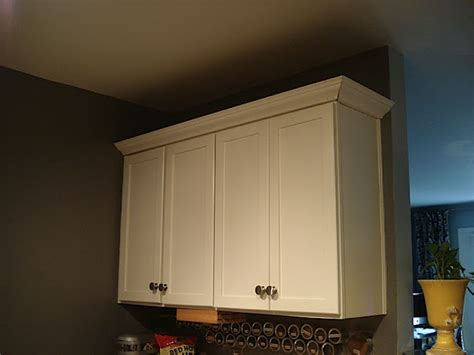 kitchen cabinet top molding add crown moulding to the top of cabinets diy 5832