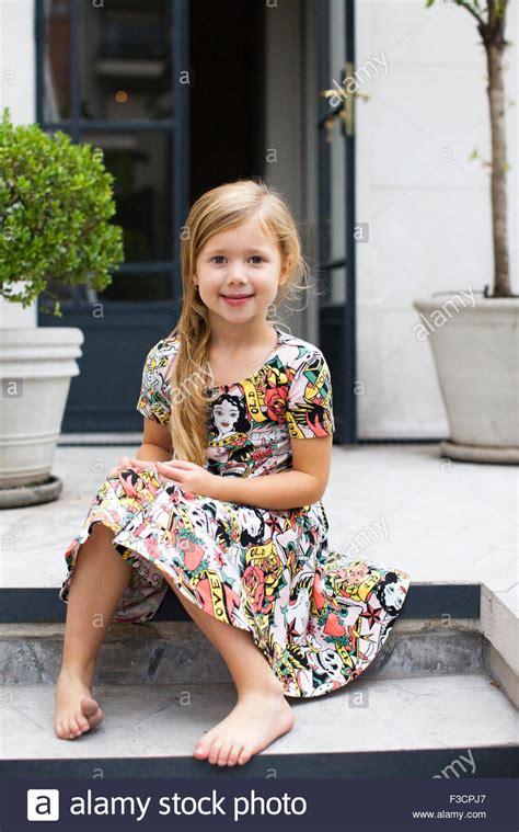 girl sitting  steps portrait stock photo