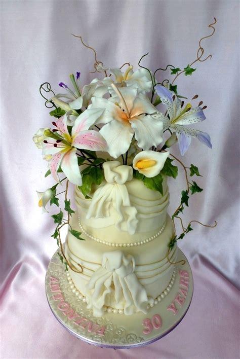 white wedding cake  drapes  gumpaste flowers