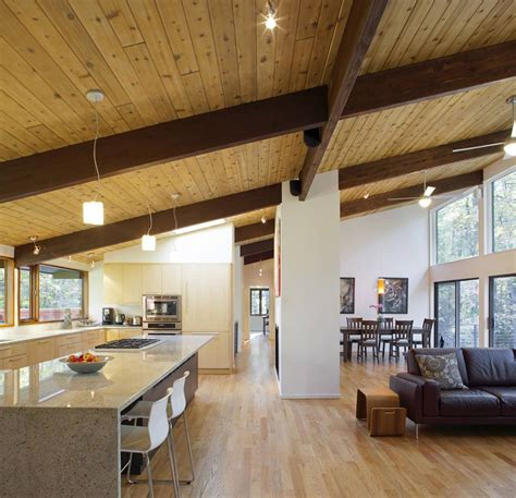 open plan kitchen living dining space deck house