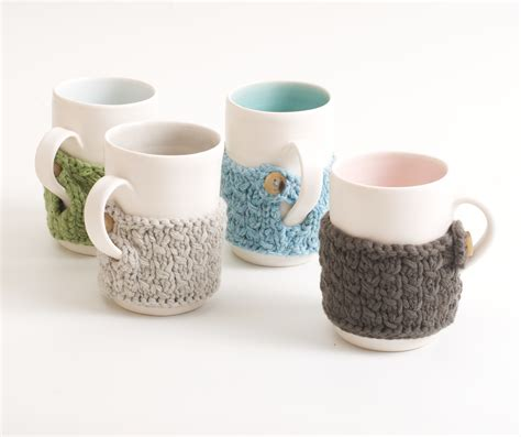 Custom mugs can be sold with seasonal designs to create a whole collection your customers won't be able to resist. Handmade mug with cosy - Linda Bloomfield