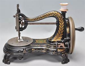 A Vintage Early 20th Century Cast Iron Sewing Machine By