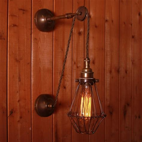 apoch pulley cage wall light by mullan lighting
