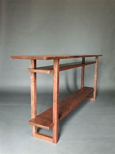 A long narrow console table with 2 shelves- handmade