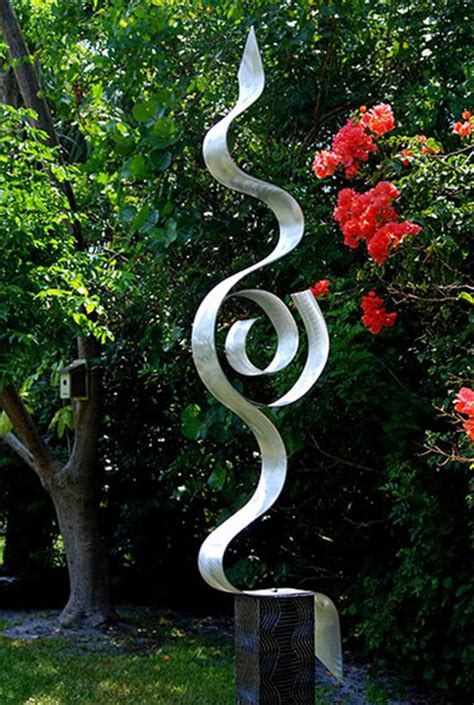 abstract silver metal garden sculpture looking forward