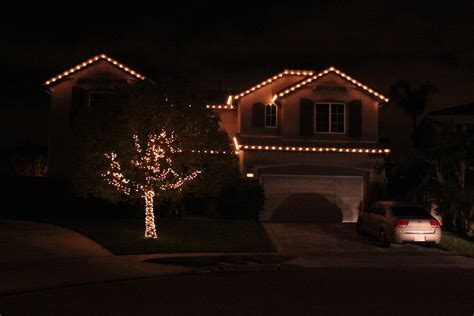tree lighting and front roofline illuminate lighting company