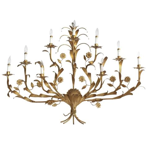 gilded metal leaf and flower wall sconce light fixture for