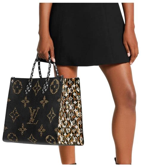 louis vuitton onthego    jungle giant monogram noir animal print black caramel leather