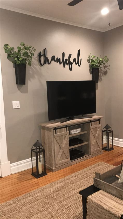 They can also be a clever way to cover your television if you don't want to worry about tv wall decor. Feather and birch,thankful sign, tv area, farmhouse decor, magnolia market   Home, Home decor ...