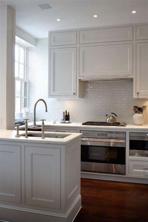kitchen peninsula with sink white glazed mini subway tiles transitional kitchen 5519