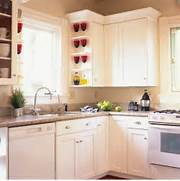 Kitchen Cabinets Is A Very Cost Effective Way To Re Do Your Kitchen Elegant L Shaped Kitchen With Island Design Ideas Adding Brown Home L Shaped Kitchen Cabinets Effect Chart Appreciation Kitchen Cool Pendant Lights Above Curved Bar Kitchen Table Small Kitchen