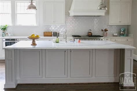 grey center island  white marble counters
