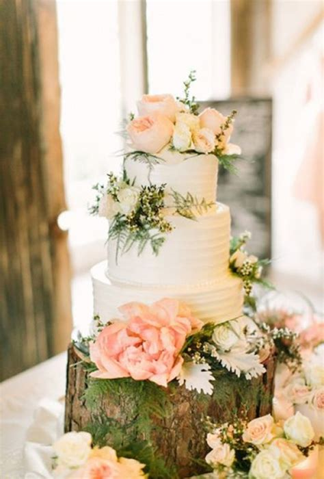 White Wedding Cake With Light Pink Flowers Brides