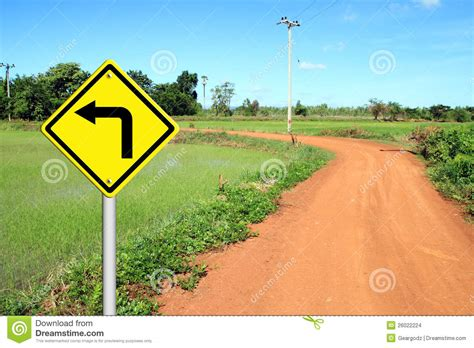 turn left warning sign  soil road stock images image