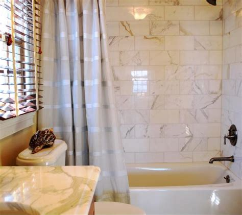 6x12 marble subway tile calcutta gold marble transitional bathroom teresa