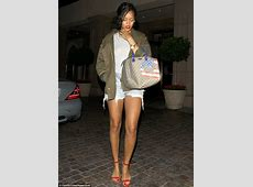 Rihanna shows off her toned legs in tiny cutoff denim