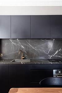 Picture Of black modern kitchen with dark marble kitchen